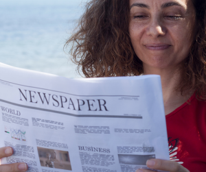 person-reading-newspaper