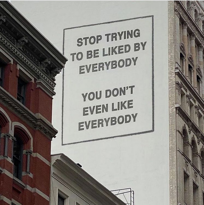 """Billboard on the side of a building that says, """"Stop trying to be liked by everybody. You don't even like everybody."""""""